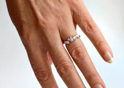 Diamond_ensemble_ring_hand